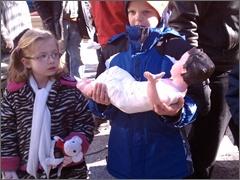 Children bring Jesus to the Manger at Daley Plaza